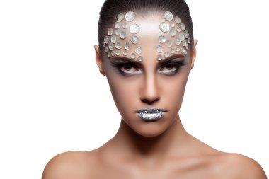 Beautiful brunette model with rhinestone fashion make up
