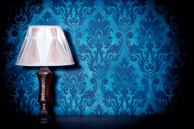 Vintage lamp on blue rococo pattern background