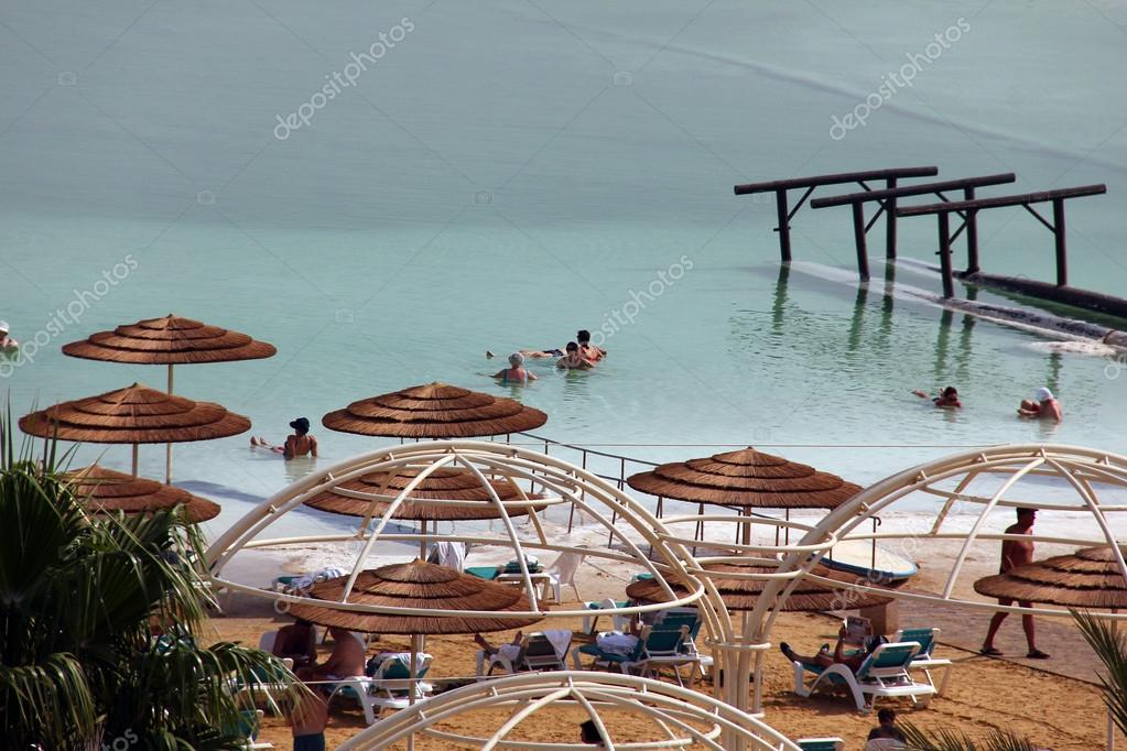 Group of tourists take water treatments at the Dead Sea