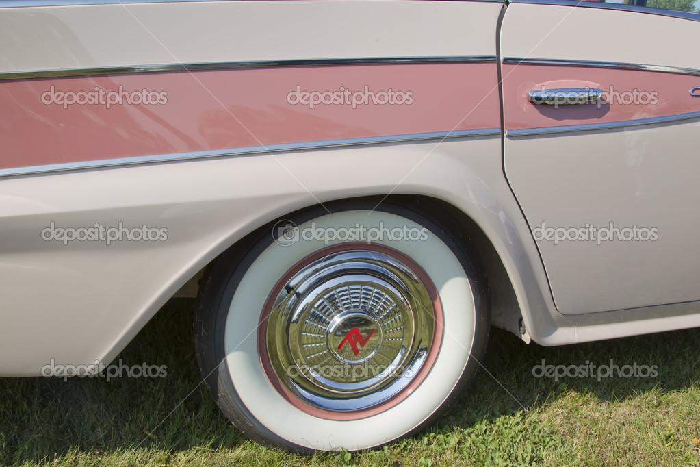 pink rambler white wall tire u2014 stock photo