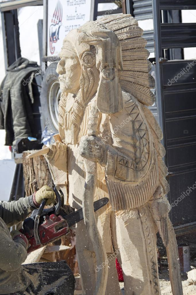 Indian chief chainsaw carving stock editorial photo