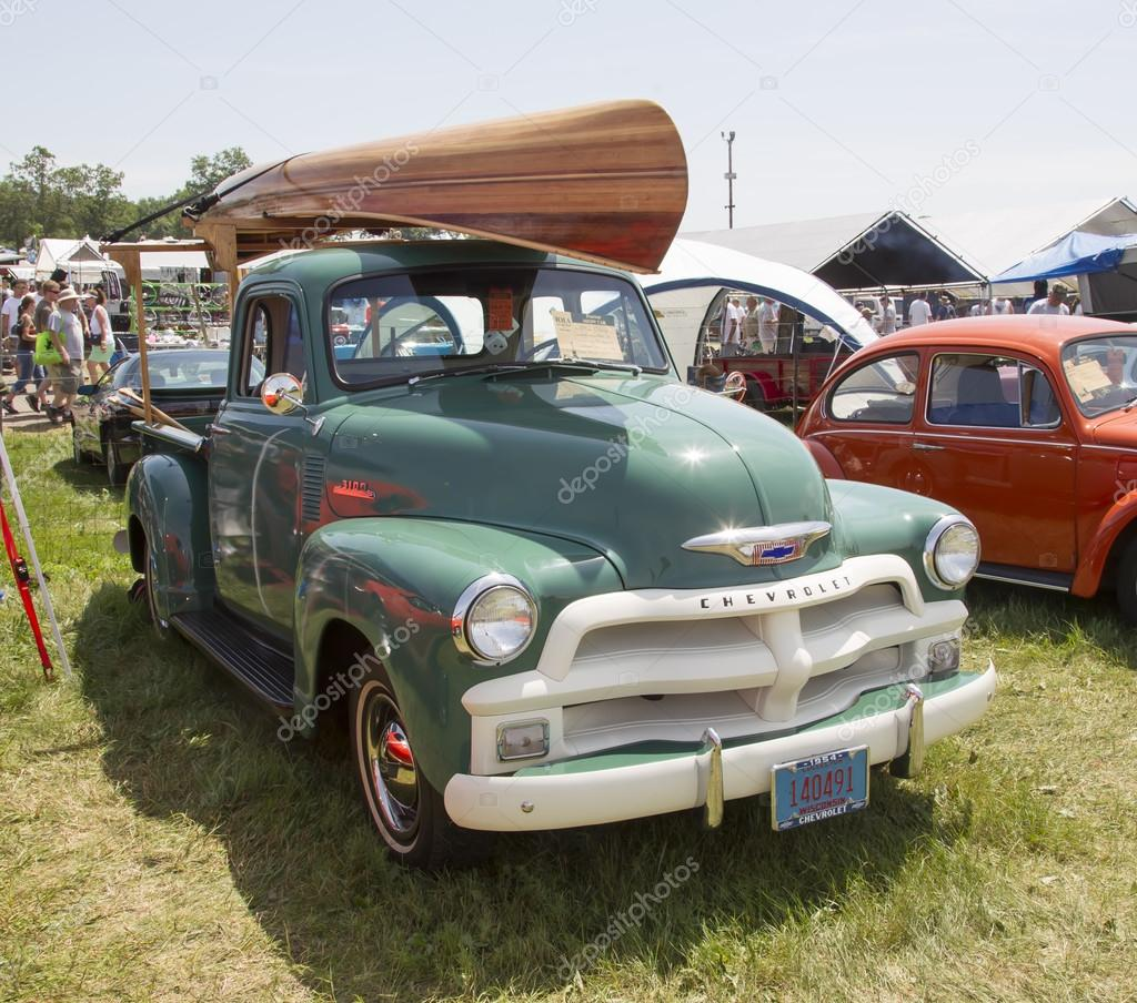 1954 Chevy 3100 Pickup With Wooden Canoe On Top Stock Editorial 1951 Truck Iola Wi July 13 At 41st Annual Car Show 2013 In Wisconsin