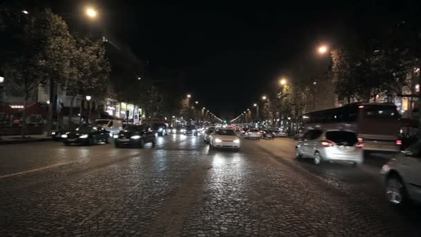 A busy car traffic at night in Paris