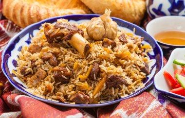 Uzbek national food on traditional fabric