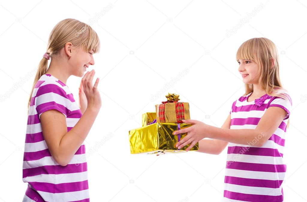 Christmas birthday gift girl giving gifts to another girl stock christmas birthday gift girl giving gifts to another girl photo by andrascsontos negle Images