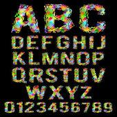 Photo Multicolored geometric polygonal broken alphabet on a black background