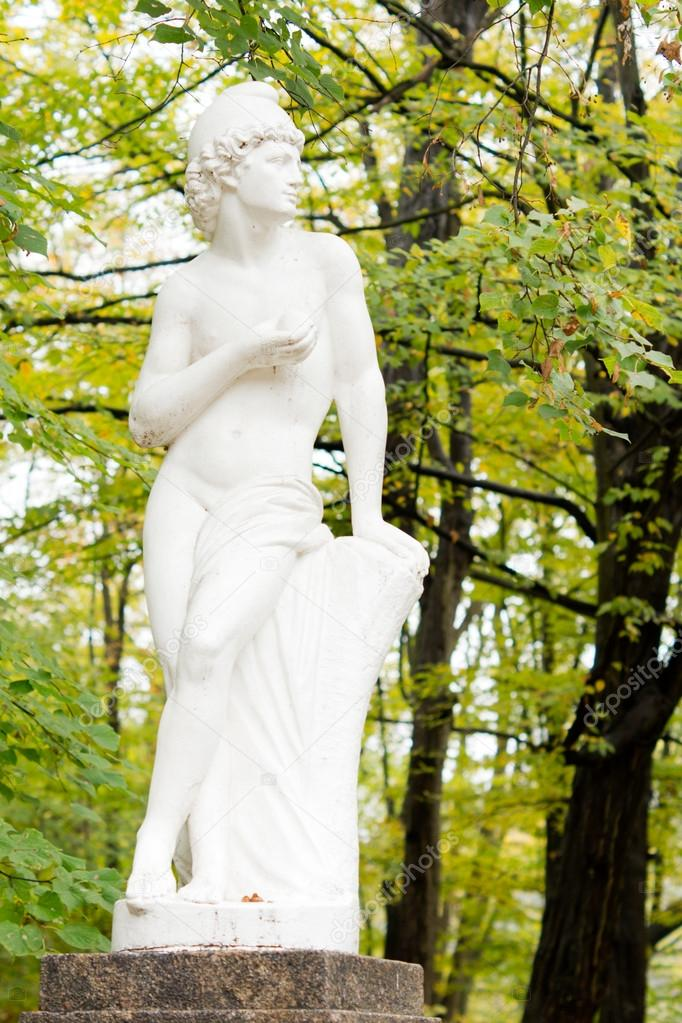 Beautiful Pristine White Garden Statue Of A Classical Greek Or Roman God On  A Stone Plinth Amongst Trees U2014 Photo By Vaicheslav