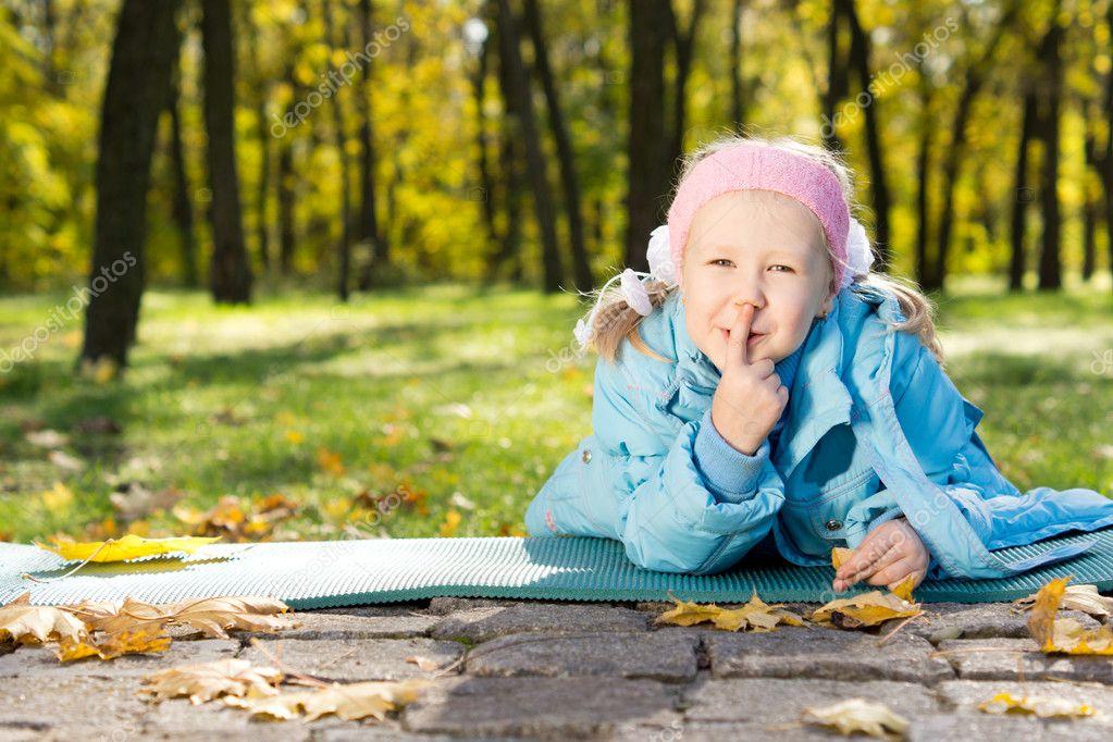 Little girl making shushing gesture