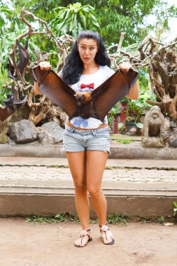Woman holding a flying fox