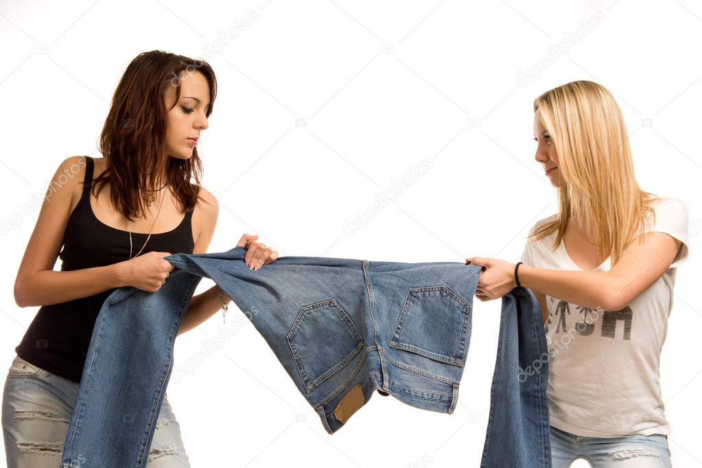 Two teenagers fighting over jeans