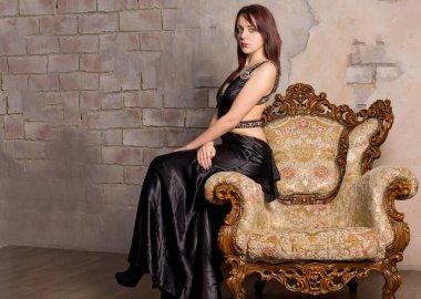 Beautiful girl on a vintage armchair