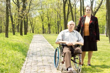 Handicapped elderly man with his wife