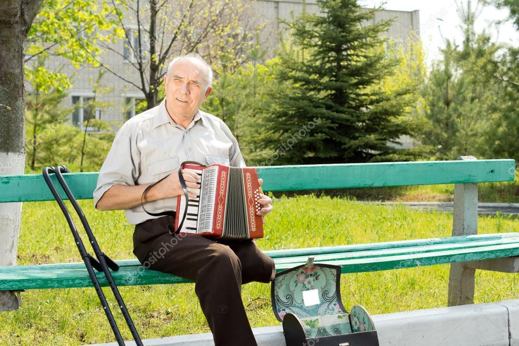 Disabled man playing the accordion