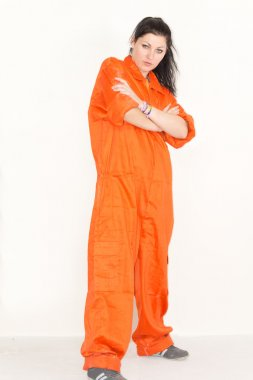 Woman posing in outsized overalls