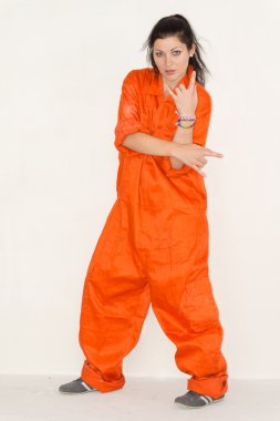 Woman in outsized overalls showing her confusion