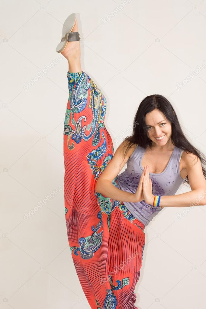 Supple young woman practising yoga