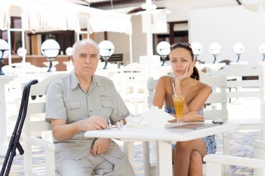 Disabled man lunching with his daughter