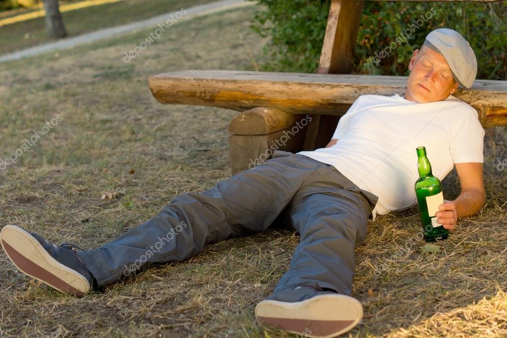 Drunk Man Fallen Asleep On The Ground Stock Photo