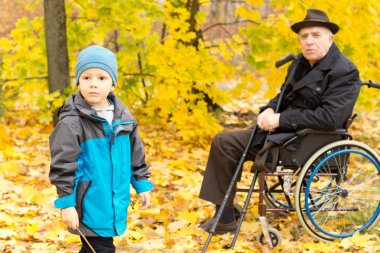Little boy with his handicapped grandfather