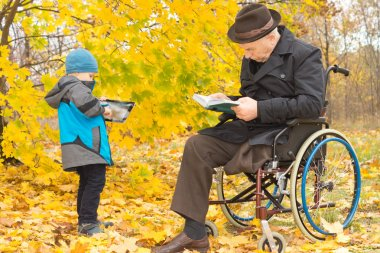 Small boy with his handicapped grandfather