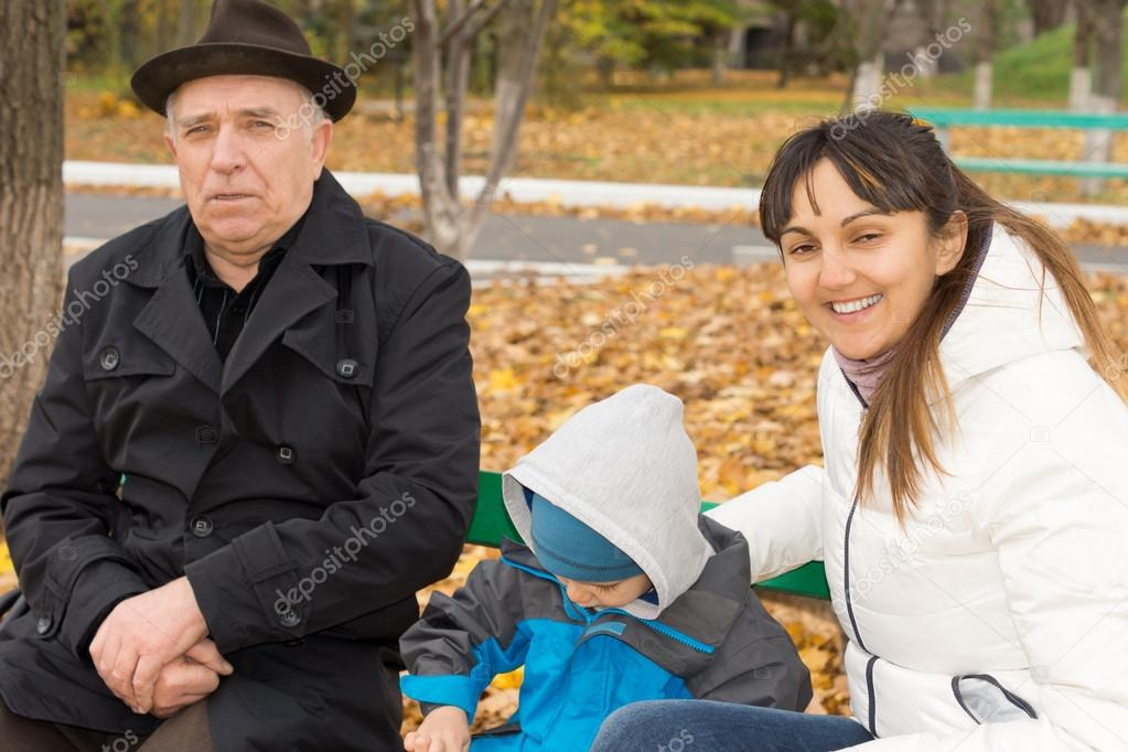 Smiling friendly woman with her son and father