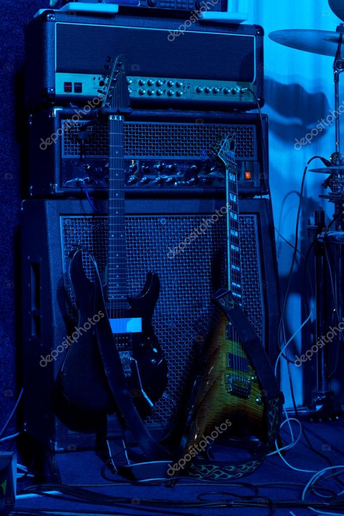 Two electric guitars backstage at a rock concert