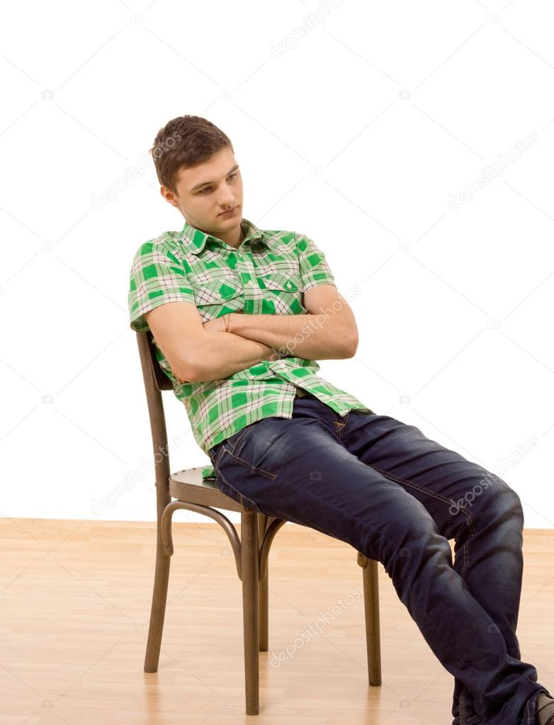 Handsome young man sitting slumped in a chair