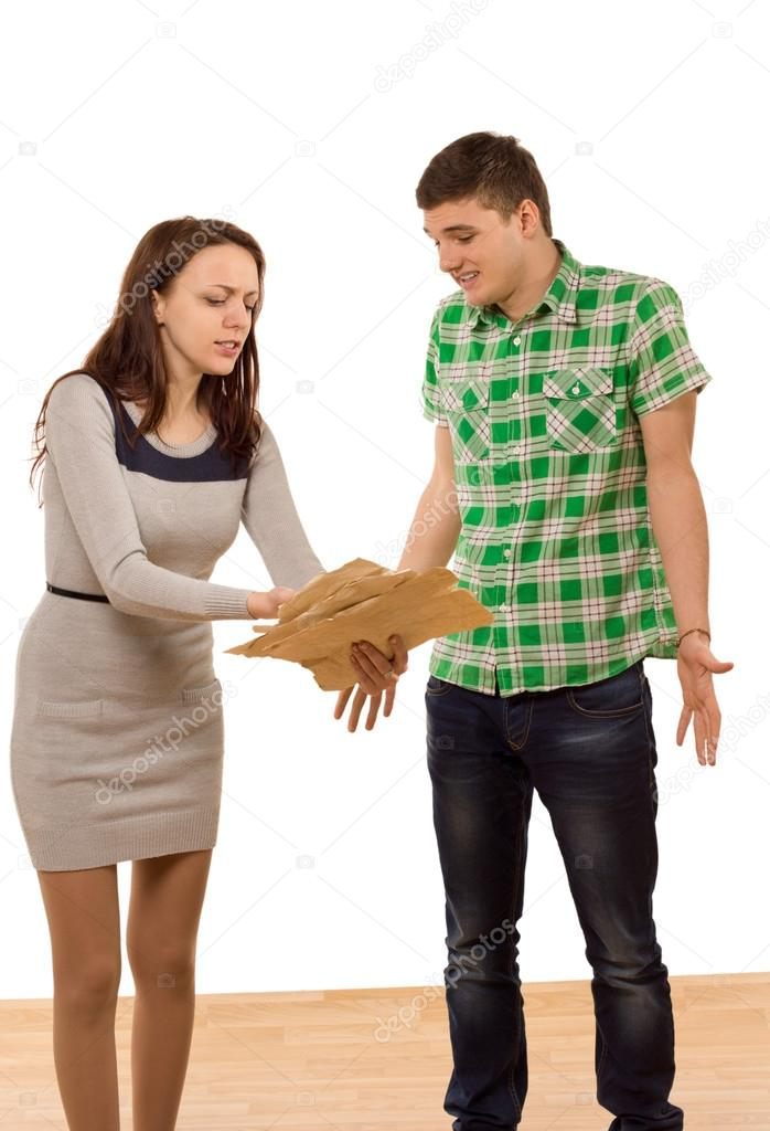 Woman accusing her boyfriend pointing to papers