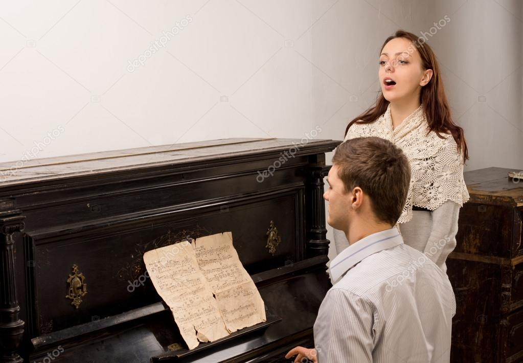 Young couple giving a singing recital
