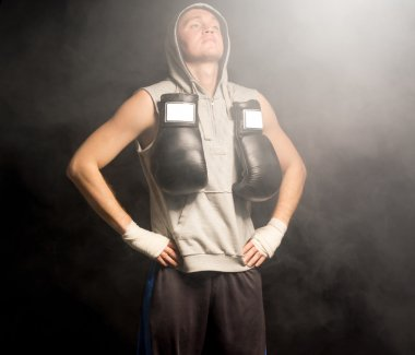 Young boxer doing breathing exercises