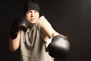 Young boxer working out in a training session