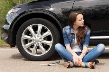 Young woman waiting for roadside assistance