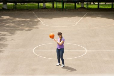 Middle aged woman playing a game of basketball
