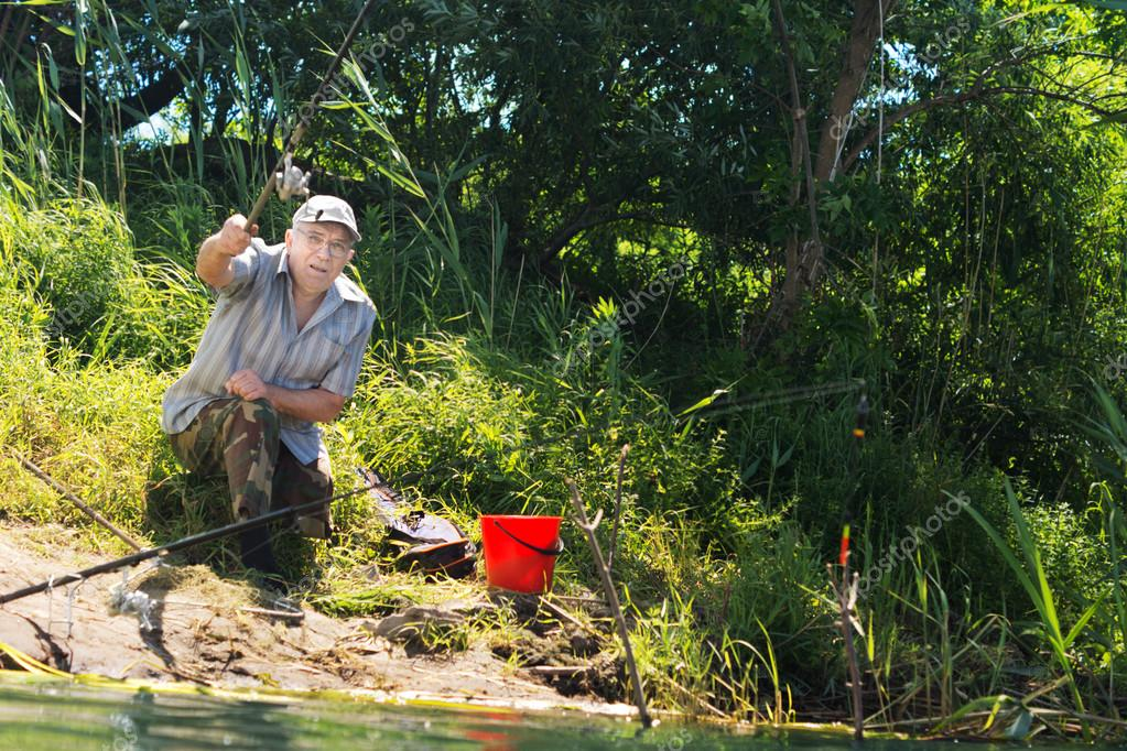 Handicapped man casting his line when fishing
