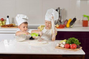 Serious Little Chefs Baking in Kitchen
