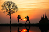 Silhouette of a thais boxing at sunset