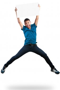 Teenager boy jumping and holding blank paper