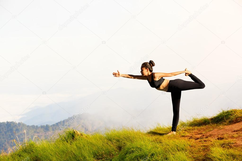 Young woman exercises yoga