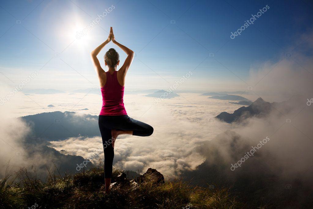 Young woman exercises yoga