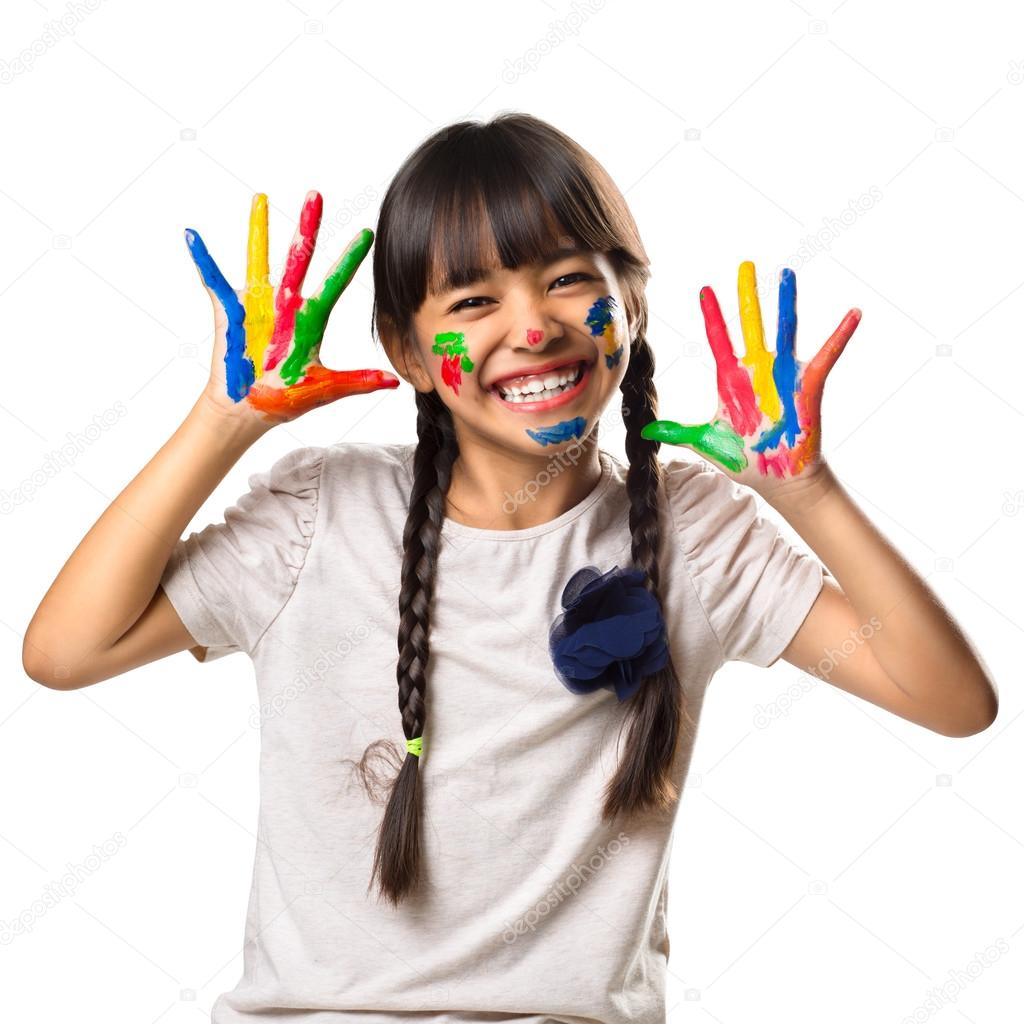 Little asian girl with her hands in the paint