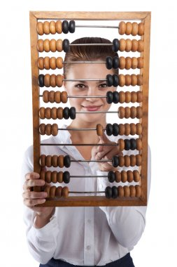 Girl holds in front of abacus