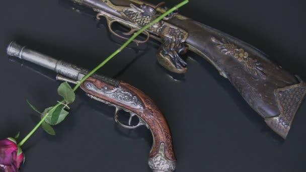 Fegyverek és rózsák