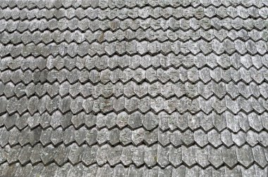 Old roof wooden texture in the form of tiles