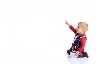 Baby in the right corner on a white background