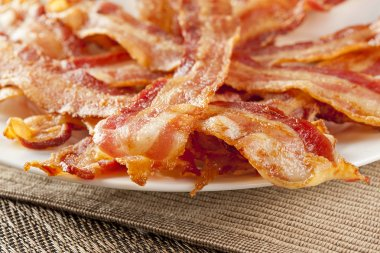 Cooked Greasy Bacon against a back ground stock vector