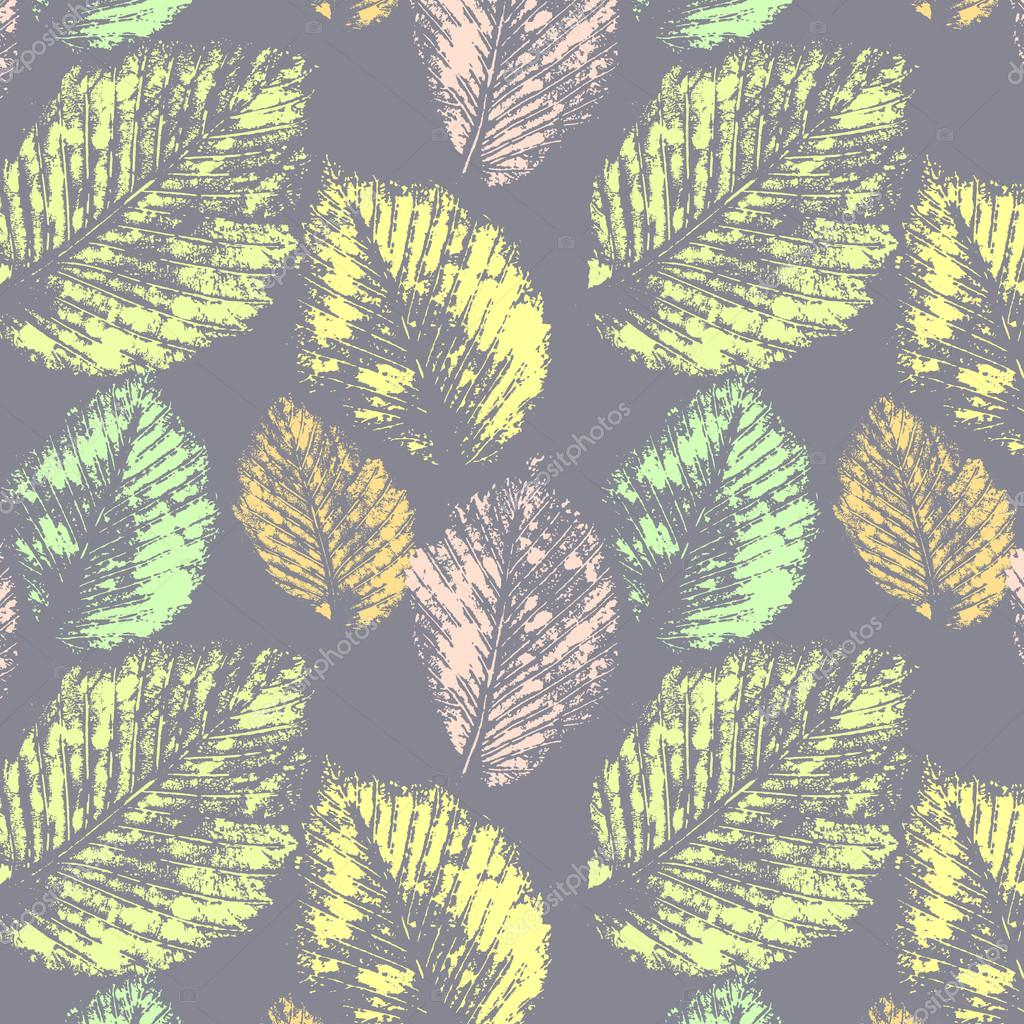 Pastel colors autumn leaves prints on gray seamless pattern, vector