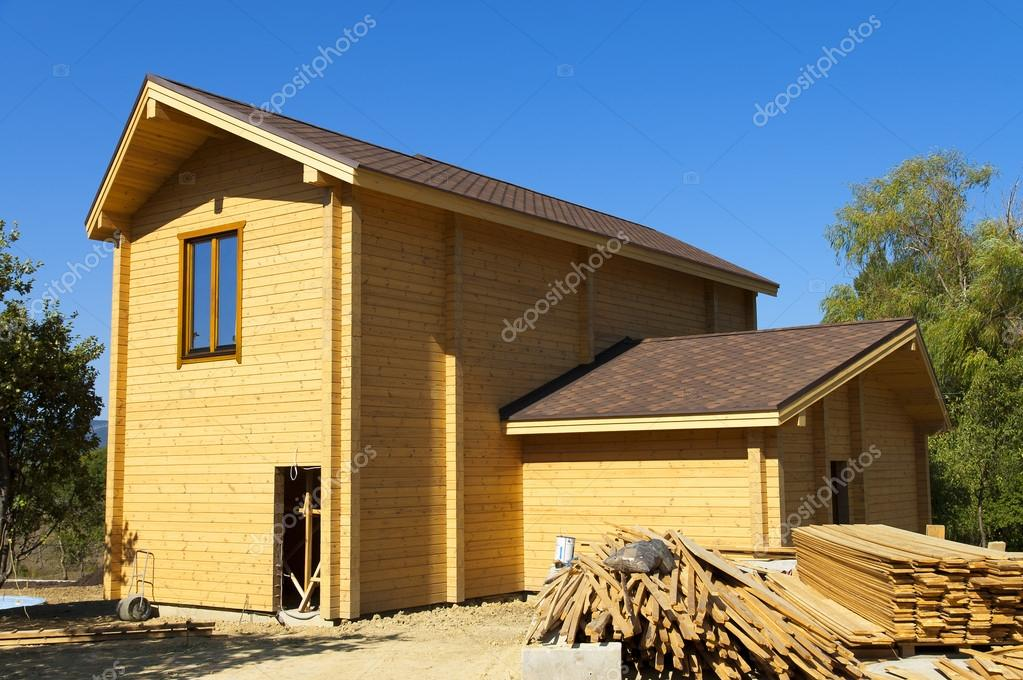 Construction of a large beautiful two-story wooden house