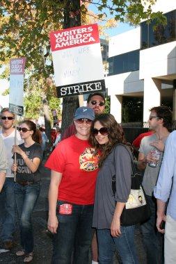 Mila Kunis & Friend