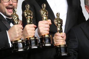 Sound editors Skip Lievsay, Niv Adiri, Christopher Benstead, and Chris Munro, winners of Best Achievement in Sound Mixing