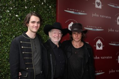 WIllie Nelson, with sons Micah and Lukas Nelson
